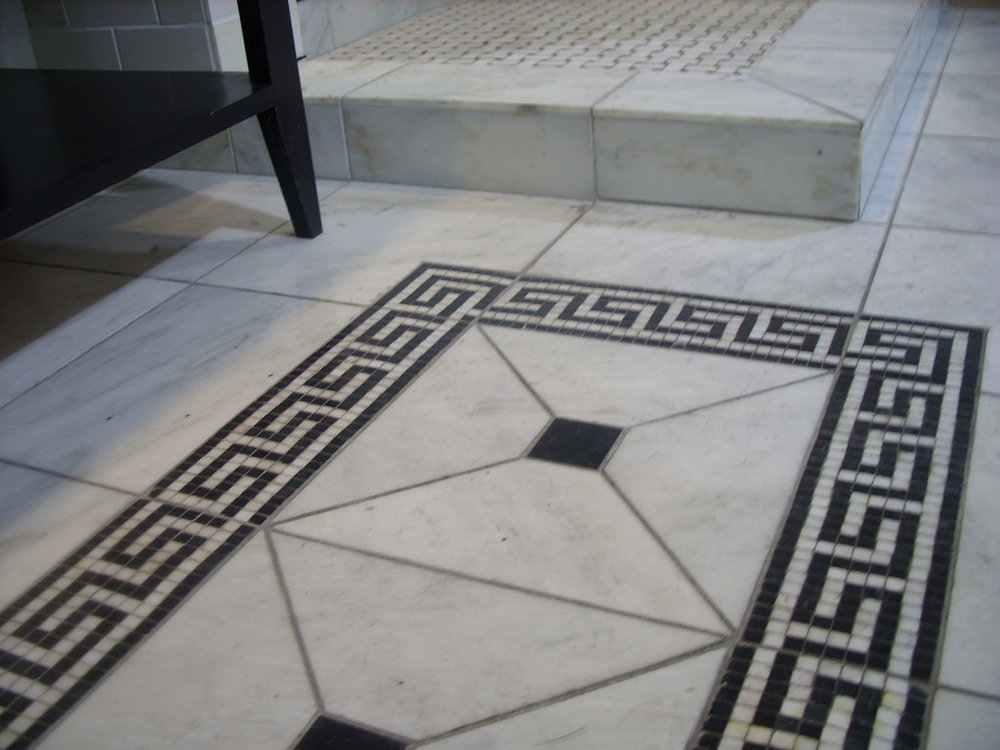 Greek inspired bath design with Marble subway tile
